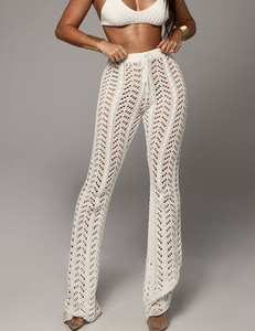 Knitted flared trousers wit